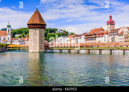 Lucerne, Switzerland. Historic city center with its famous Chapel Bridge and City Hall.(Vierwaldstattersee) - Stock Photo