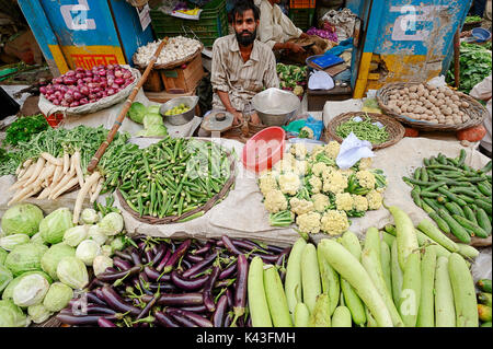 Market stall with White Cabbage, Eggplant, Bottle Gourd, Radish, Okra, Cauliflower, Cucumber, Onions and Potatoes, - Stock Photo