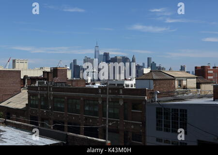 View towards skyline of Manhattan from Red Hook, Brooklyn, New York on July 03, 2017. - Stock Photo