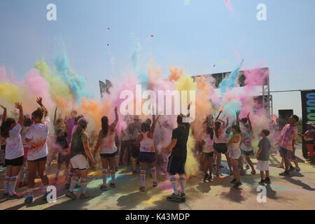 Runners throw color bombs in the air after complete the Color Me Rad 5K marathon run at the Marine Corps Air Station Miramar August 22, 2015 in San Diego, California.  (photo by Kimberlyn Adams via Planetpix)