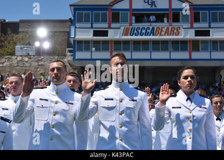 U.S. Coast Guard ensigns take the Oath of Office during the U.S. Coast Guard Academy commencement ceremony May 17, - Stock Photo