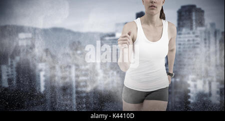 Athlete woman running on white background against white dust powder - Stock Photo
