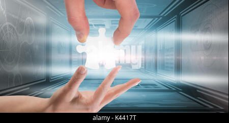 hands holding jigsaw against digital composite image of business charts - Stock Photo