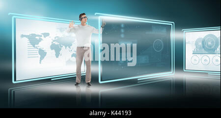 Young man gesturing while using virtual video glasses against vector image of business graphs and map in 3d - Stock Photo