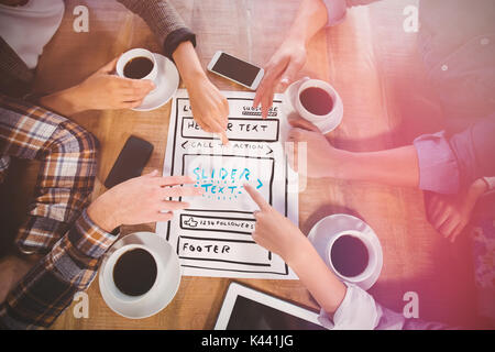 Illustration of website against friends discussing and drinking coffee - Stock Photo