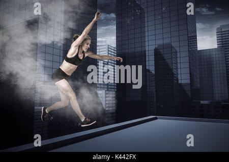 Athletic woman exercising on white background against splashing of color powder - Stock Photo