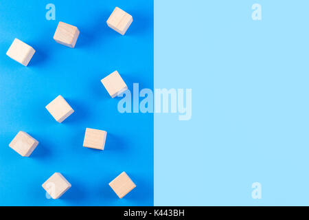 Wooden blocks on blue tone background. - Stock Photo