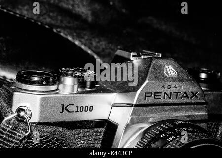A black and white image of an older asahi pentax k1000 camera stock photo