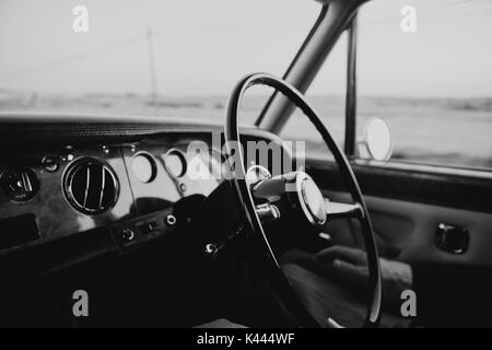 Inside view of classic and luxury car in black and white - Stock Photo
