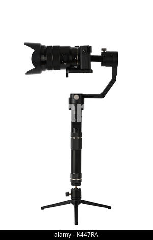 3-axis gimbals Stabilization System with Mirrorless Camera. Using this equipment, a Videographer can take video - Stock Photo