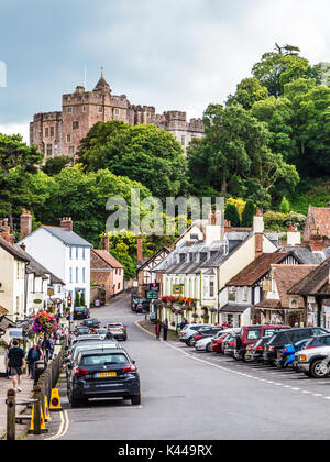 View down the High Street towards the castle in Dunster near Minehead, Somerset. - Stock Photo