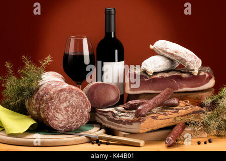 Still life, mixed salami, typical products, red wine, Trentino, AltoAdige, Dolomites, food, - Stock Photo