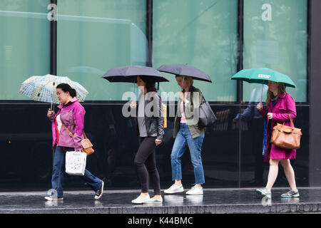 London,, UK. 4th September 2017. People with umbrellas walking near London Bridge during rain and wet weather. Credit: - Stock Photo