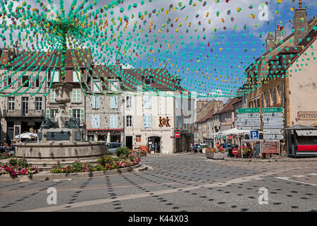Fountain at decorated Liberty Square / place de la Liberté in the town Arbois, commune in the Jura department, Franche - Stock Photo
