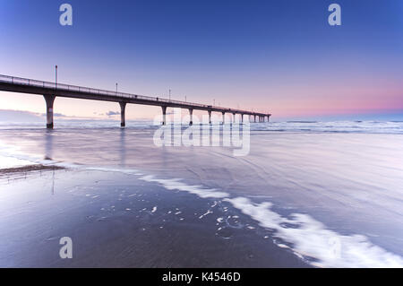 Pier at New Brighton Beach sunset view in Christchurch, South Island, New Zealand. - Stock Photo
