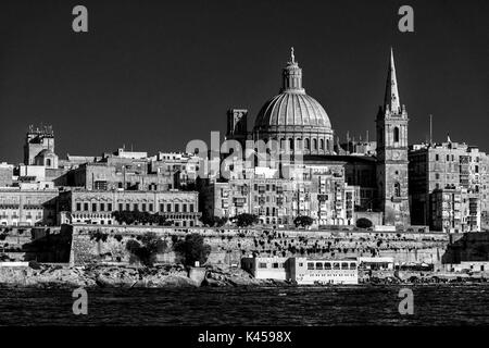 Black and White scenic summer view of Valletta, capital of Malta, across from Sliema, looking over Marsamxett Harbour - Stock Photo