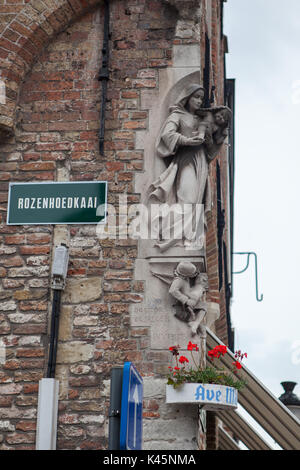 The modern statue of Madonna on the edge of house. Bruges Belgium - Stock Photo
