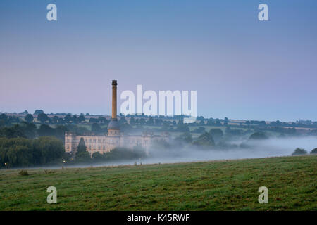 Early morning mist before sunrise over Bliss Tweed Mill. Chipping Norton, Oxfordshire, England - Stock Photo