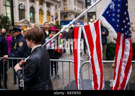USA, New York, New York City, Mid-Town Manhattan, protester with torn US flag outside Trump Tower, NR - Stock Photo