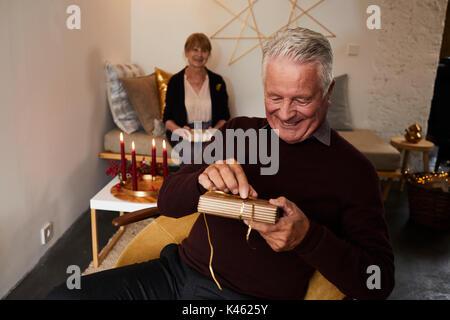Senior couple with Christmas presents - Stock Photo