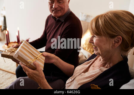 Senior couple with Christmas presents, half portrait - Stock Photo
