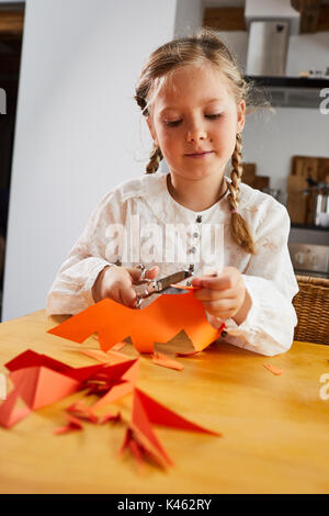 Girl cozy at home while crafting, half portrait - Stock Photo