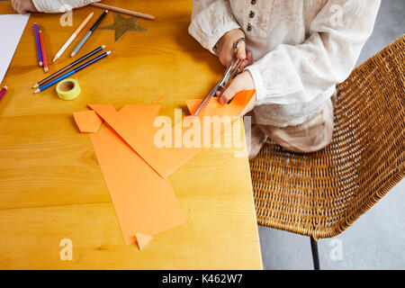 Children while crafting at Christmas time, detail - Stock Photo
