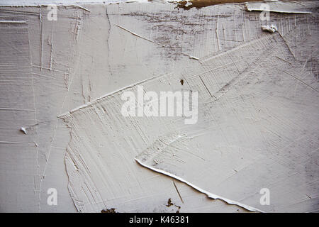 white Structural and textured plaster dabbed on wall - Stock Photo