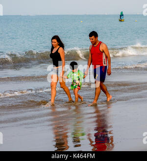 Family walks on beach, in Salinas, Ecuador on Nov 23, 2011 - Stock Photo