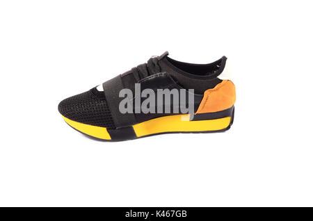 Women's athletic shoes isolated on white background - Stock Photo