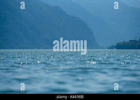 Sparking water of Lake Idro from Baitoni, smaller lake in Brescia, Italy - Stock Photo
