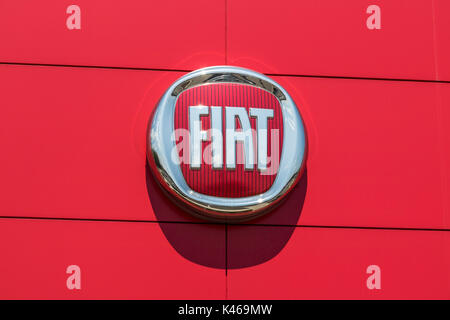 Indianapolis - Circa August 2017: Logo and signage of local Fiat dealership. Fiat is part of FCA and sells both - Stock Photo