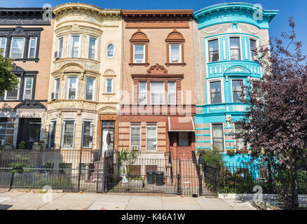A row of historic brick apartment buildings on St. Francis Place in the Crown Heights Neighborhood of Brooklyn, - Stock Photo