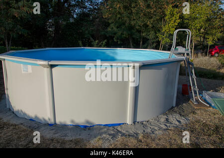 View of a metal frame swimming pool just mounted Stock Photo ...