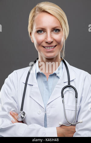 Portrait of a smiling young female doctor - Stock Photo