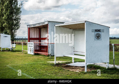 Grass roots football. Basic shelters and match stand for teams and personnel. Langtoft United Football Club home - Stock Photo