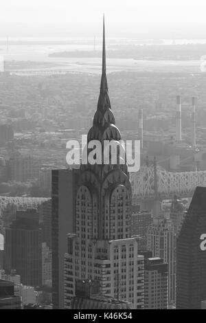 Chrysler Building top detail, aerial view in black and white in New York - Stock Photo