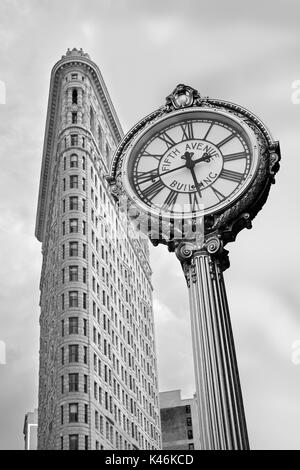 Flatiron and Fifth Avenue building golden clock in black and white in New York City - Stock Photo