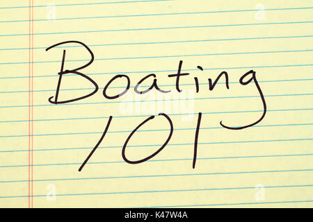 The words 'Boating 101' on a yellow legal pad - Stock Photo