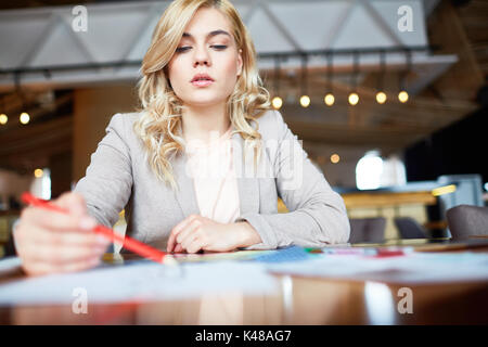 Pretty Designer Wrapped up in Work - Stock Photo