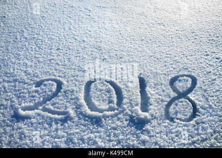 abstract  New Year's and Christmas background from snow.text on snow 2018 - Stock Photo