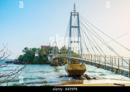 The view on beautiful footbridge to the Parey Dewa temple, located on Pigeon island, Matara, Sri Lanka - Stock Photo