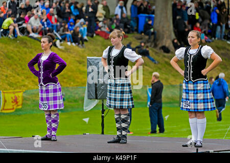 Girls In Kilted Skirts Performing A Highland Dance, Ceres, Scotland, United Kingdom - Stock Photo