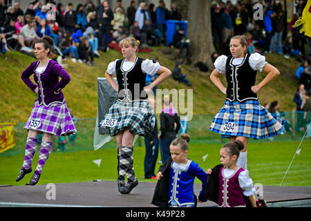 Girls In Kilted Skirts Performing At The Highland Dancing Competition At The Ceres Highland Games, Scotland, Great - Stock Photo