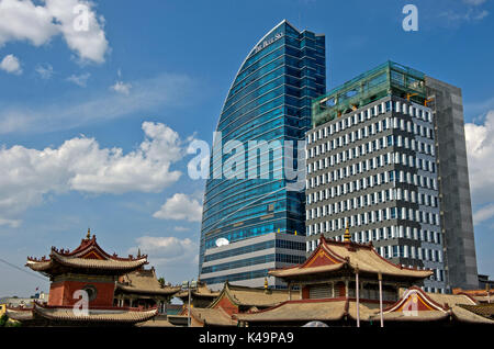 Modern High, Rising Rise Above The Traditional Choijin Lama Temple, Ulaanbaatar, Mongolia - Stock Photo