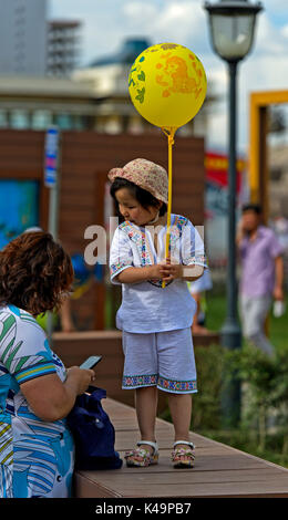 6 To 7, Year Old Girl With Balloon, Ulaanbaatar, Mongolia - Stock Photo