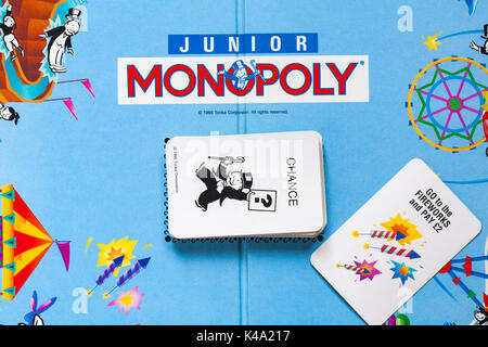 Junior Monopoly game - monopoly board with pile of chance cards - details looking down on - Stock Photo