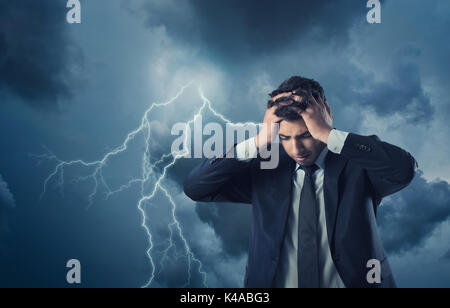 Bankrupted businessman with depressed look on his face - Stock Photo