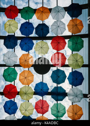 Colorful Umbrellas Hanging In Sky - Stock Photo