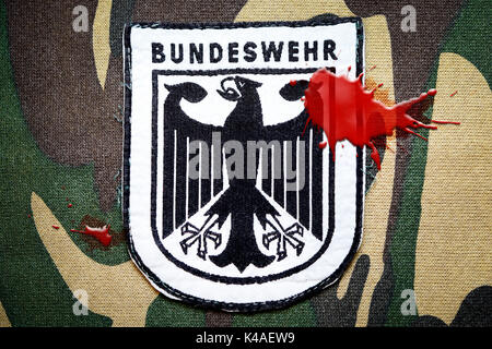 German Armed Forces Emblem With Blood Stain, Bundeswehr Scandal - Stock Photo